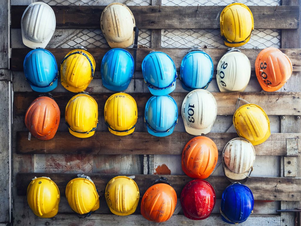 Hardhats hanging on a wall
